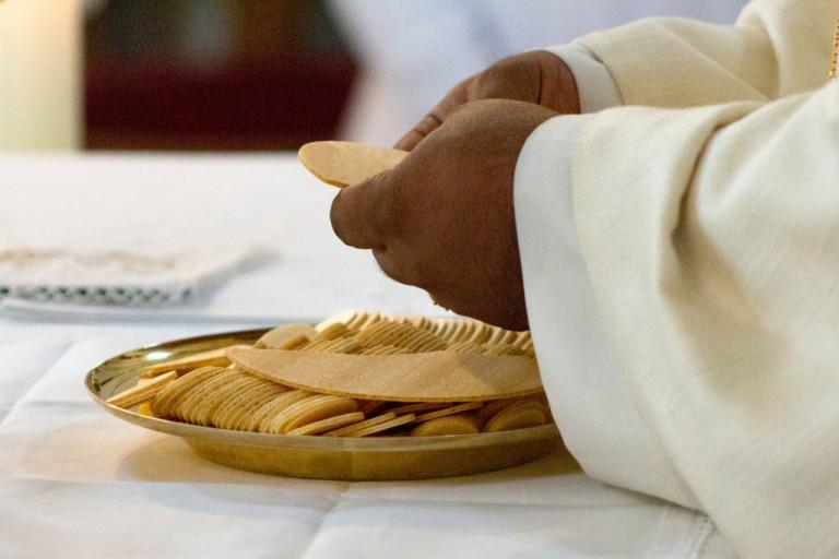 Eucharistie breken van brood